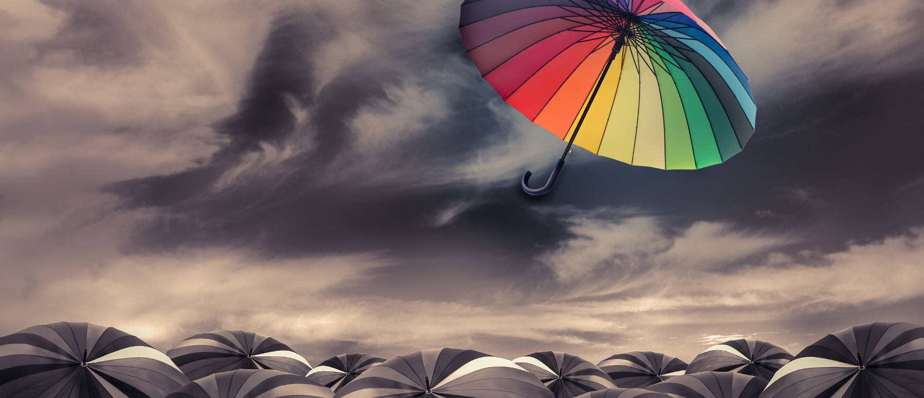 rainbow umbrella fly out the mass of black umbrellas - Be different ! - www.crea3.com